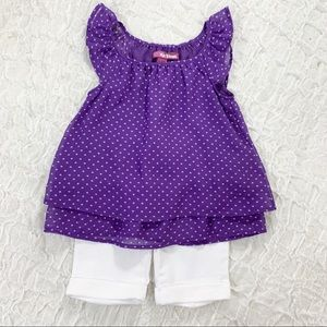 Girls purple top and white Bermuda shorts outfit